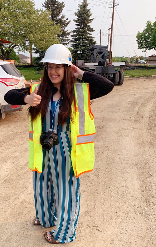 Student in hard hat with a camera.