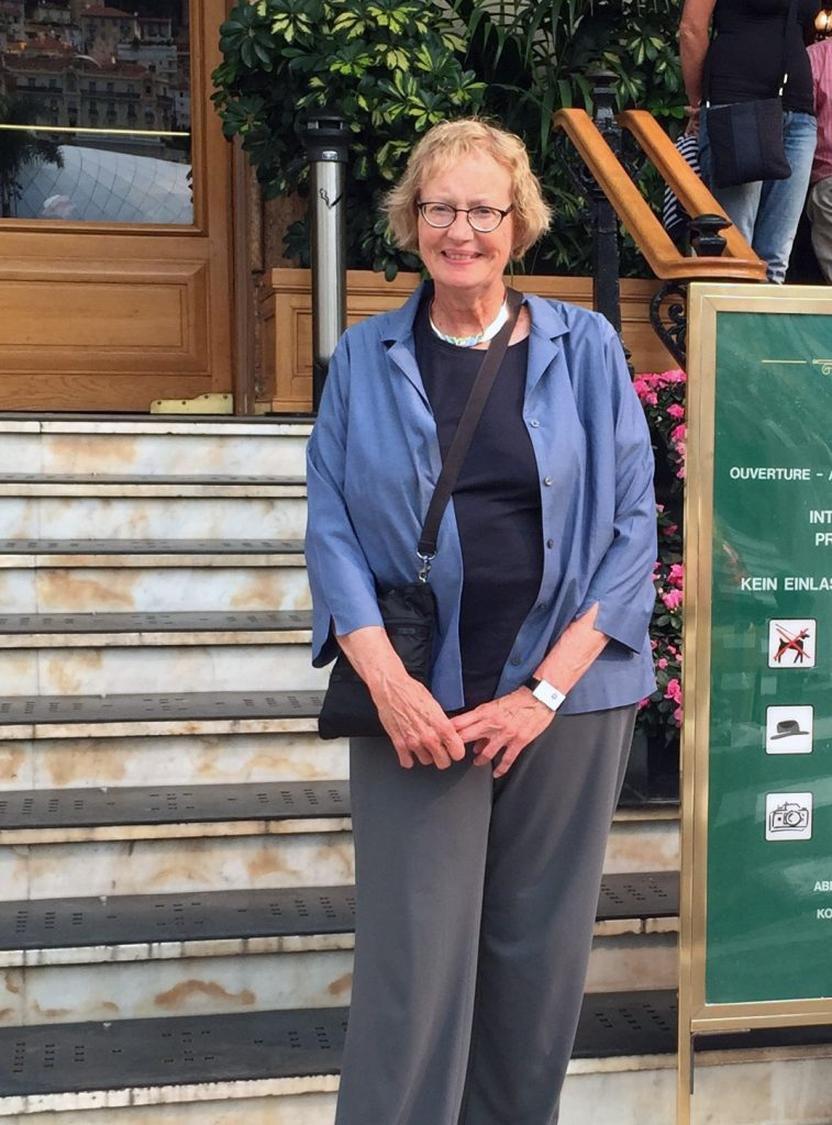 Photo of Ann Bohlke in front of steps.
