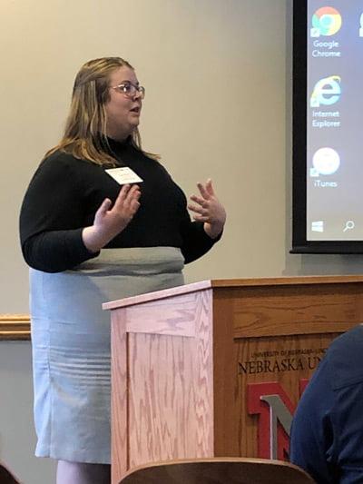Courtney Hanson at a podium