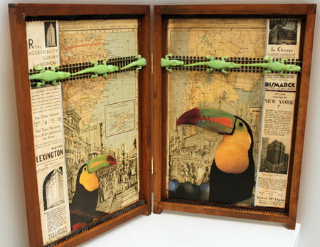 An art box with newspaper clippings and other materials