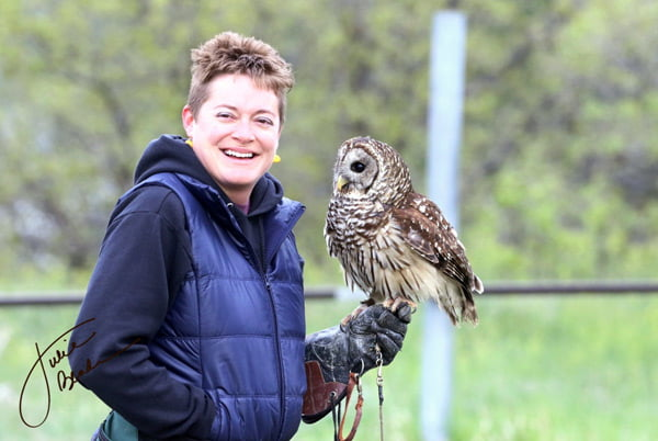 Devin Jaffe '09 and her barred owl, Wicket, educate audiences about wildlife and conservation. (Photo by Julie Bender.)