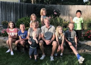 A photo of Doug and Diane Phelps and their grandchildren.