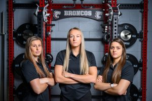 Photo of Cassidy Dyhrkopp, Ally Ginkens and Shandra Farmer, who are members of the Hastings College Human Performance staff.