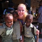 Emma Johnson with children in Haiti