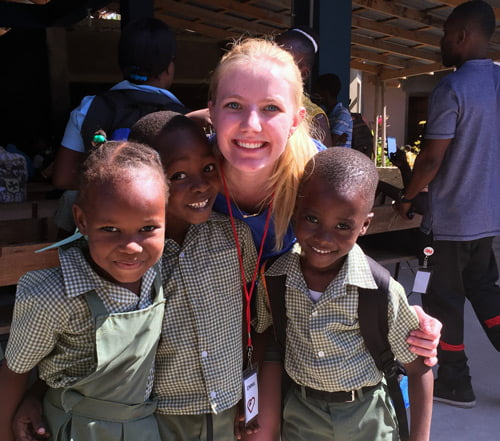 Emma Johnson with children in Haiti