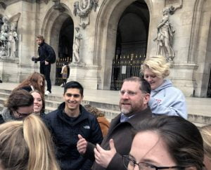 Group of students on steps in front of Paris Opera house.