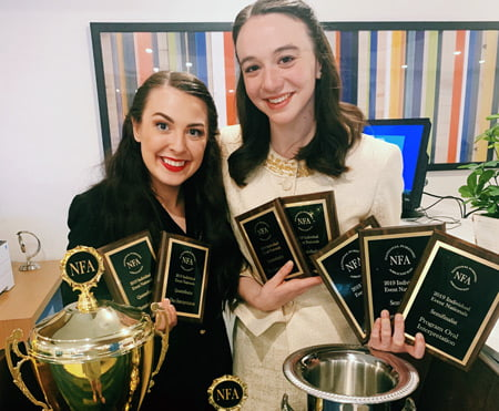 Photo of Alli Kennon and Carly Spotts-Falzone with trophies.