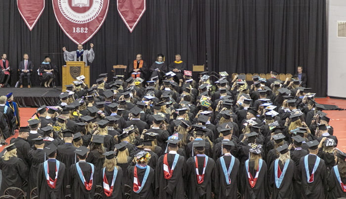 Photo of graduating students in an arena.