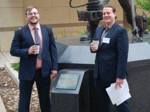 Photo of James Lapka and Austin Heinlein outside.