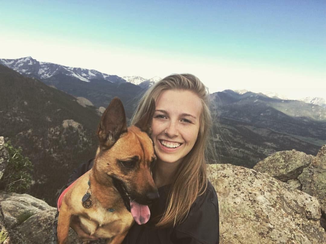 Photo of a woman and her dog near Estes Park, Colorado.