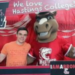 Student with a college mascot.