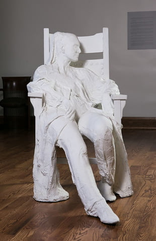 Photo of artwork by George Segal, Woman in Armchair.