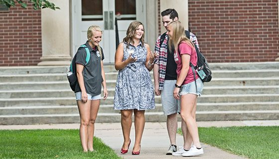 Students working with an admissions counselor