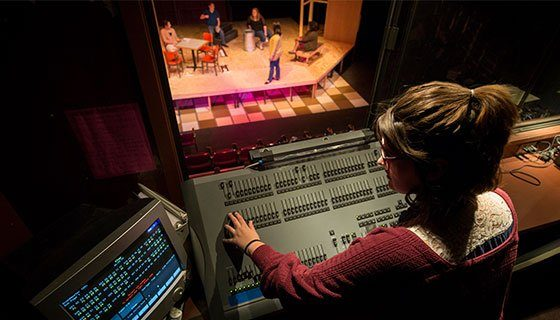 Student working in the control room at Scott Studio Theatre