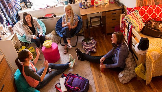 Students hanging out in a Taylor Hall dorm room