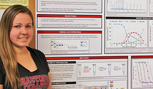 Heidi Roth with her presentation poster