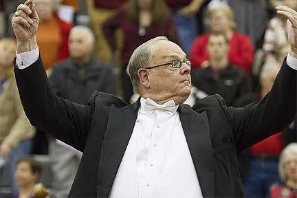Dr. Robin Koozer conducting