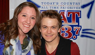 Hastings College student Lauren Sawyer with Grammy-nominated country star Hunter Hayes. Sawyer met Hayes during her internship with Clear Channel.
