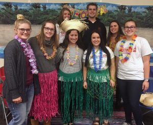 Picture of several college students in luau apparel.