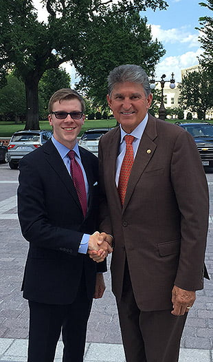 Nick Musgrave shakes hands with Senator Joe Manchin on Capitol Hill in Washington, D.C. Musgrave spent the summer in Manchin's office working as a press intern.
